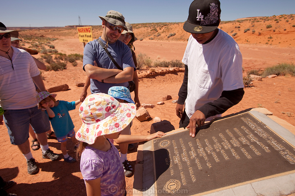 Page, Arizona. Lower Antelope Canyon, slot canyon above ground entrance with flash flood warning and monument to those who drowned there in 1997.