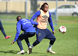 Cape Town-180823- Cape Town City player Edmilson Dove challenged  by team mate Craig Martin  at training preparing for their up comingMTN 8 semi-final against Sundowns at Cape Town Stadum.Photographer :Phando Jikelo/African News Agency/ANA