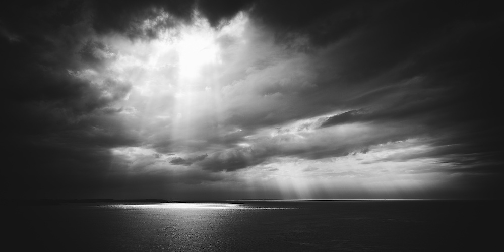 Dramatic skies over the sea viewed from the Pointe du Grouin, Brittany, France