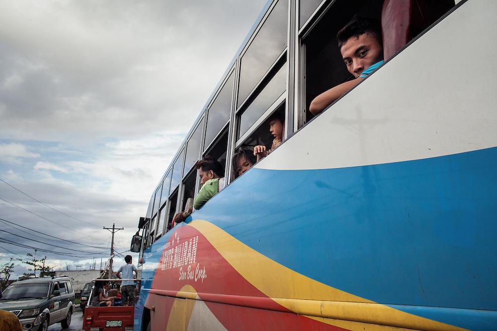 Passengers inside a bus departing Tacloban City.