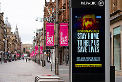 Glasgow, Scotland, UK. 1 April, 2020. Effects of Coronavirus lockdown on Glasgow life, Scotland. Video screen showing coronavirus warning message on Buchanan Street.