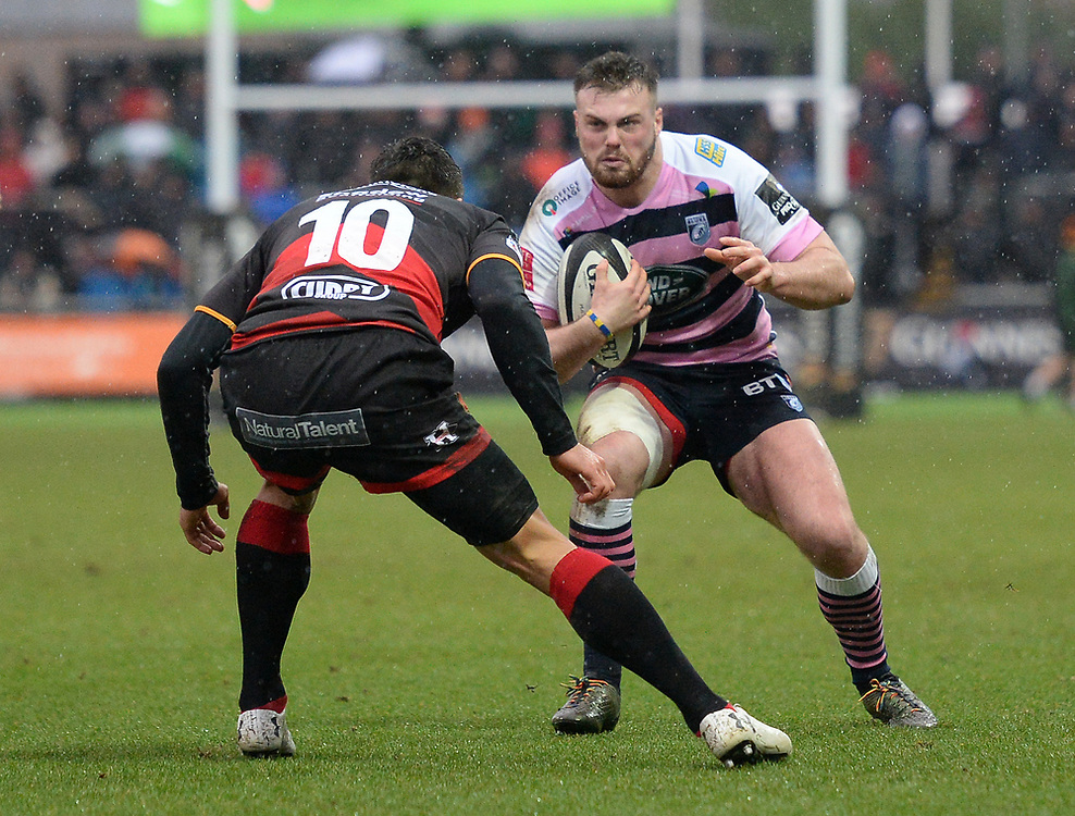 Cardiff Blues' Owen Lane takes on Dragons' Gavin Henson<br /> <br /> Photographer Ian Cook/CameraSport<br /> <br /> Guinness Pro14 Round 11 - Dragons v Cardiff Blues - Tuesday 26th December 2017 - Rodney Parade - Newport<br /> <br /> World Copyright © 2017 CameraSport. All rights reserved. 43 Linden Ave. Countesthorpe. Leicester. England. LE8 5PG - Tel: +44 (0) 116 277 4147 - admin@camerasport.com - www.camerasport.com