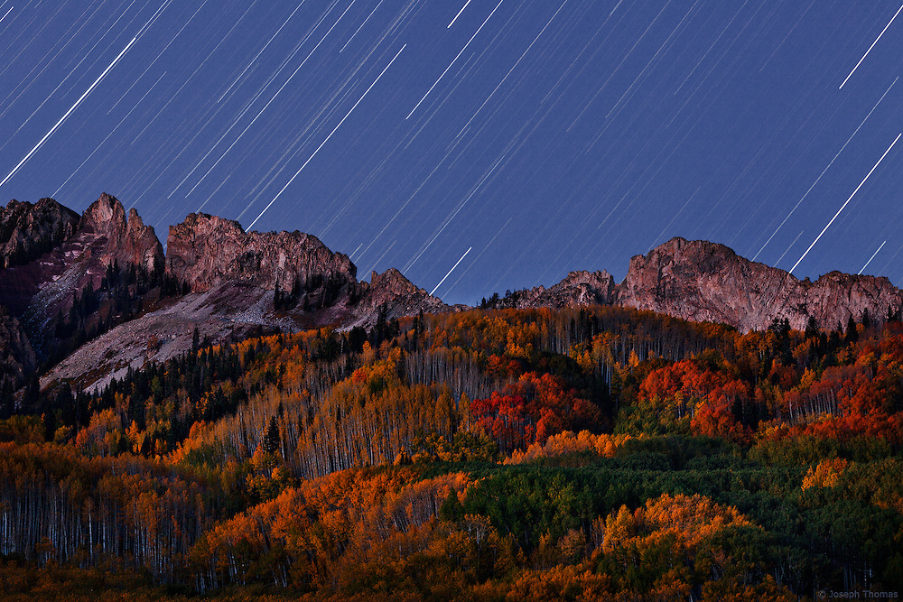 A long exposure causes startrails that appear to rain down on the Ruby Range.
