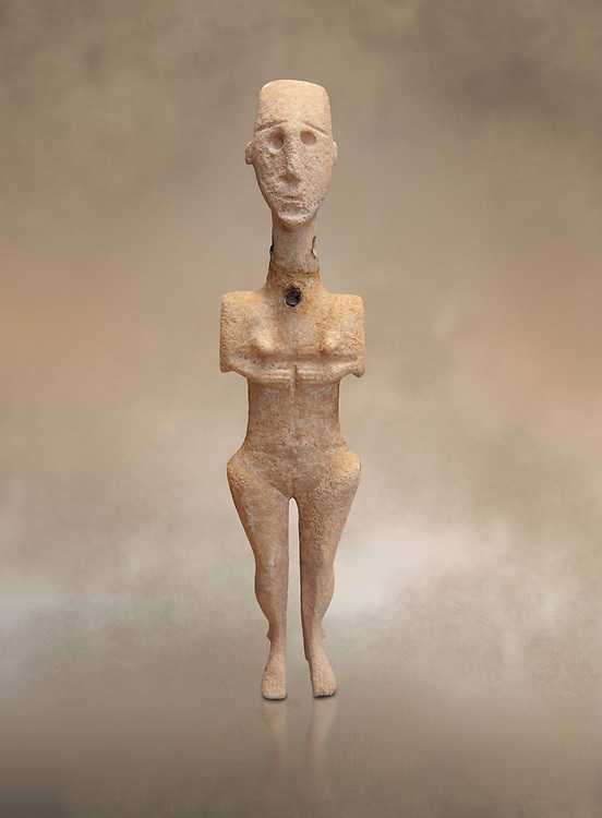 Cycladic statue figurine of the naturalistic 'Plastira' type of Paros. Early Cycladic Period I (Grotta-Pelos Phase 3200-2800 BC). National Archaeological Museum, Athens. <br /> <br /> This type of Cycladic figurine stand with feet lat to the ground with detailed facial features and ears to make a more realistic statue. .<br /> <br /> If you prefer to buy from our ALAMY PHOTO LIBRARY  Collection visit : https://www.alamy.com/portfolio/paul-williams-funkystock/cycladic-art-artefacts.html Type into the LOWER SEARCH WITHIN GALLERY box to refine search by adding background colour, place, museum etc<br /> <br /> Visit our CYCLADIC CIVILISATIONS PHOTO COLLECTIONS for more photos to download or buy as wall art prints https://funkystock.photoshelter.com/gallery-collection/Cycladic-civilisation-Ancient-Greek-Artefacts-art-Photos-Pictures-Images/C0000CmevVvnC.XU