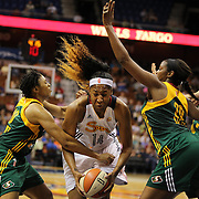 Kelsey Bone, (centre), Connecticut Sun, derives to the basket defended by Tanisha Wright, (left) and Camille Little, Seattle Storm, during the Connecticut Sun Vs Seattle Storm WNBA regular season game at Mohegan Sun Arena, Uncasville, Connecticut, USA. 23rd May 2014. Photo Tim Clayton