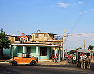 Old American car and horse drawn wagon in Pinar del Rio, Cuba.