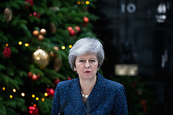 © Licensed to London News Pictures. 12/12/2018. London, UK. British Prime Minister Theresa May makes a statement outside 10 Downing Street announcing that she will contest tonight's vote of no confidence in her leadership, after 48 letters were handed in this morning. Photo credit : Tom Nicholson/LNP