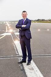 Matt shadowing Edinburgh Airport's chief exec Gordon Dewar as he runs Scotland's busiest airport. Pic on the runway.
