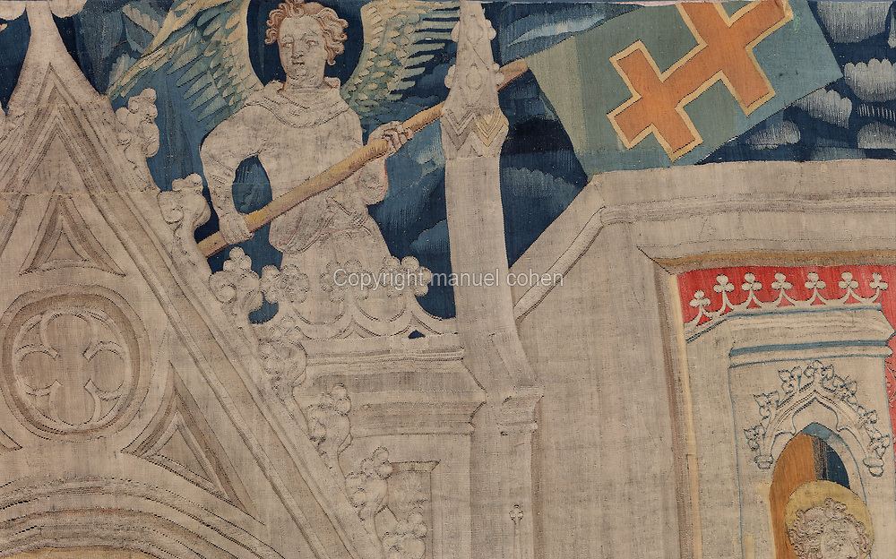 Angel holding banner with the Anjou cross, detail of the beginning of the fifth piece depicting the 7 Cups, from the Tenture de l'Apocalypse or Apocalypse Tapestry, made 1373-82 by Nicolas Bataille in the workshop of Robert Poincon after preparatory drawings by Hennequin de Bruges, in the Musee de la Tapisserie de l'Apocalypse, in the Chateau d'Angers, Angers, Maine-et-Loire, France. The tapestry was commissioned by Louis I duc d'Anjou and depicts the Apocalypse of John. It measures 140m and is divided into 6 pieces with 90 scenes. Although bequeathed to Angers Cathedral by King Rene in the 15th century, the tapestry was reconstructed and restored in the 19th century, listed as a historic monument and exhibited in the castle. Picture by Manuel Cohen