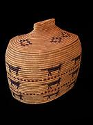 Oblong Yupik grass basket with seal gut imbrication and fox design, Alaska.