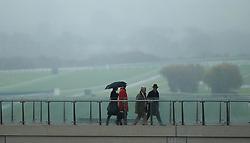 Racegoers on the horse walk bridge during day one of the November Meeting at Cheltenham Racecourse, Cheltenham