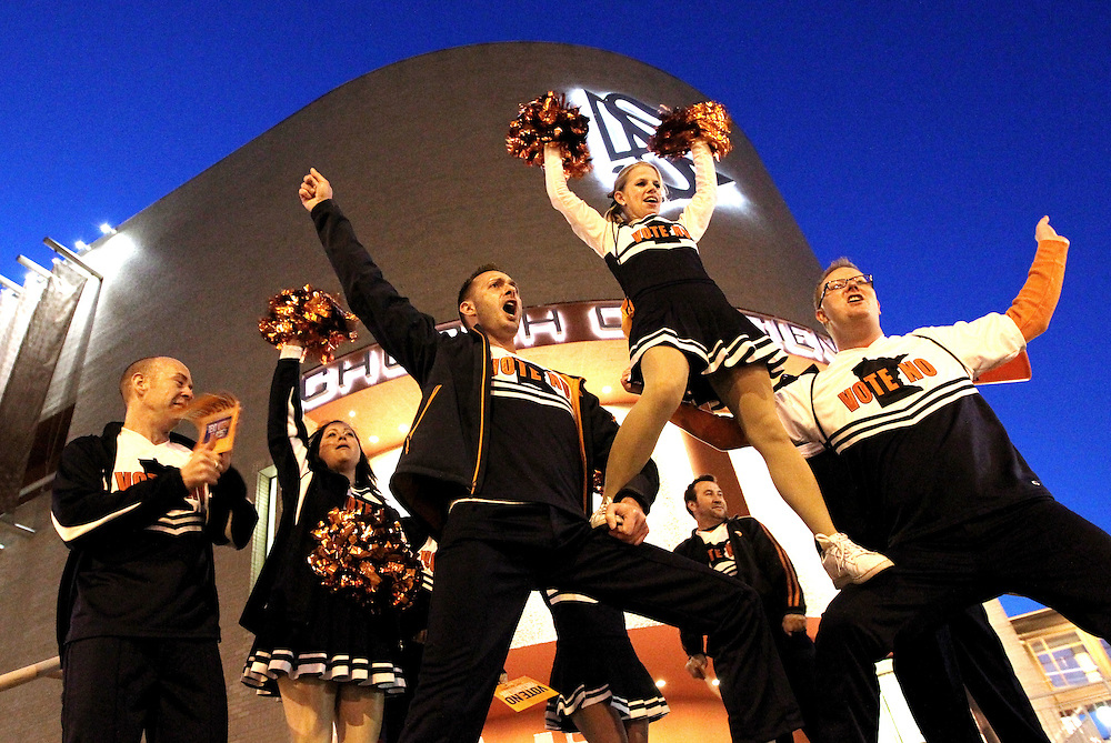 The Vote No Cheer Squad led by Justin Readhead, center, performs on the corner of Wabasha and Exchange Streets prior to the Marriage Amendment Debate hosted by Kerri Miller and presented by Minnesota Public Radio News at the Fitzgerald Theater in St. Paul, Minnesota. .