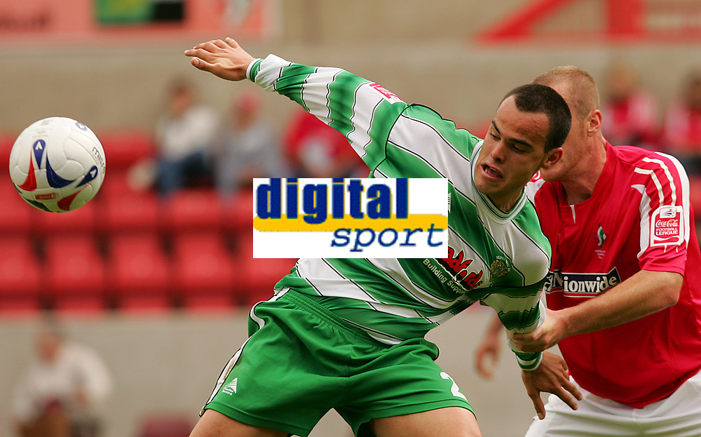 Fotball<br /> England 2005/2006<br /> Foto: SBI/Digitalsport<br /> NORWAY ONLY<br /> <br /> Swindon v Yeovil<br /> Coca Cola League 1.<br /> 27/08/2005.<br /> <br /> Yeovil's goal scorer Paolo Bastianini is pulled by Swindon's Sean O'Hanlon