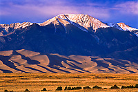 The Great Sand Dunes below 13,297 ft. Herard Peak of the Sangre de Cristo Mountains.  Great Sand Dunes National Park, Colorado, USA.