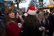 Wearing antlers and a Santa hat, friends hanging out at the Christmas market. The South Bank is a significant arts and entertainment district, and home to an endless list of activities for Londoners, visitors and tourists alike.