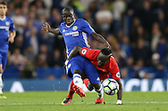 Ngolo Kante of Chelsea and Sadio Mane of Liverpool compete for the ball. Premier league match, Chelsea v Liverpool at Stamford Bridge in London on Friday 16th September 2016.<br /> pic by John Patrick Fletcher, Andrew Orchard sports photography.