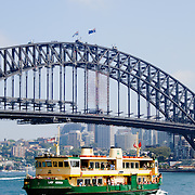 Sydney Ferry and Sydney Harbour Bridge on a sunny day in Australia