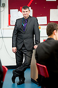 "EXCLUSIVE<br /> Academy teacher also a wrestler known as the Essex Bad Boy<br /> <br /> School teacher Paul Tyrrell isn't your classic Essex Bad Boy.<br /> But, once the bell goes at the end of the school day, the award-winning science tutor is certainly ready for a fight.<br /> By day, the father-of-three is taken extremely seriously by his teenage audience in the classroom at Maltings Academy, in Essex, winning national recognition for his work. By night, he transforms into a secret alternative persona…Essex Bad Boy, the wrestling star.<br /> The 39-year-old has been body-slamming his opponents around the world for the last 25 years, having his first professional wrestling match at the age of 14 – the youngest in the UK at the time.<br /> He now splits his time between school and the wrestling ring, using his teacher training to coach the next generation of performers. According to the star, it works both ways and his wrestling experience has also helped him to take charge in the classroom.<br /> ""You might not think it, but there are many similarities between teaching and wrestling. Wrestling is obviously about entertaining the crowd, with someone playing the good guy and someone playing the bad guy. We use psychology to tell the story and to get the crowd involved and on side. Teaching is the same, with us using psychology to get the kids' attention, playing the bad guy when they've not done their homework and the good guy to earn their respect. <br /> ""I don't see myself as an educator; I see myself as an edu-tainer. I use entertainment to draw the kids in in the classroom. I tell funny stories, I constantly move around, we play games and act out role play; there's no sitting around in my classes. There are a lot of crossovers which have helped me improve as a teacher and as a wrestler.""<br /> Paul's wrestling career took off when he was just 16 and travelled to America to train with Exotic Adrian Street. On his way to the top, he defeated childhood hero Jake the Snake Roberts before forming a tag"