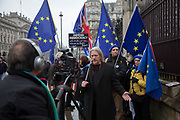 Anti Brexit protester gives an interview in Westminster outside Parliament on 22nd January 2020 in London, England, United Kingdom. With a majority Conservative government in power and Brexit day at the end of January looming, the role of these protesters is now to demonstrate in the hope of the softest Brexit deal possible.