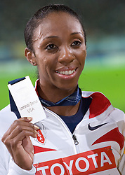 Lashinda Demus of United States receives the silver medall during the medal ceremony for the women's 400 Metres Hurdles Final during day six of the 12th IAAF World Athletics Championships at the Olympic Stadium on August 20, 2009 in Berlin, Germany. (Photo by Vid Ponikvar / Sportida)