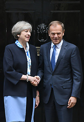 File photo dated 06/04/17 of Prime Minister Theresa May with European Council president Donald Tusk outside 10 Downing Street, London, as he has said that Britain must agree to honour its outstanding financial commitments to the European Union before talks about trade can begin.