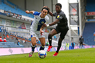 Lewis Travis of Blackburn Rovers  goes past Madger Gomes of Doncaster Rovers  during the EFL Cup match between Blackburn Rovers and Doncaster Rovers at Ewood Park, Blackburn, England on 29 August 2020.