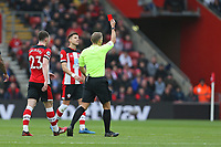 Football - 2019 / 2020 Premier League - Southampton vs. Newcastle United<br /> <br /> Referee Mr Graham Scott gives Southampton's Moussa Djenepo a red card for foul play during the Premier League match at St Mary's Stadium Southampton <br /> <br /> COLORSPORT/SHAUN BOGGUST