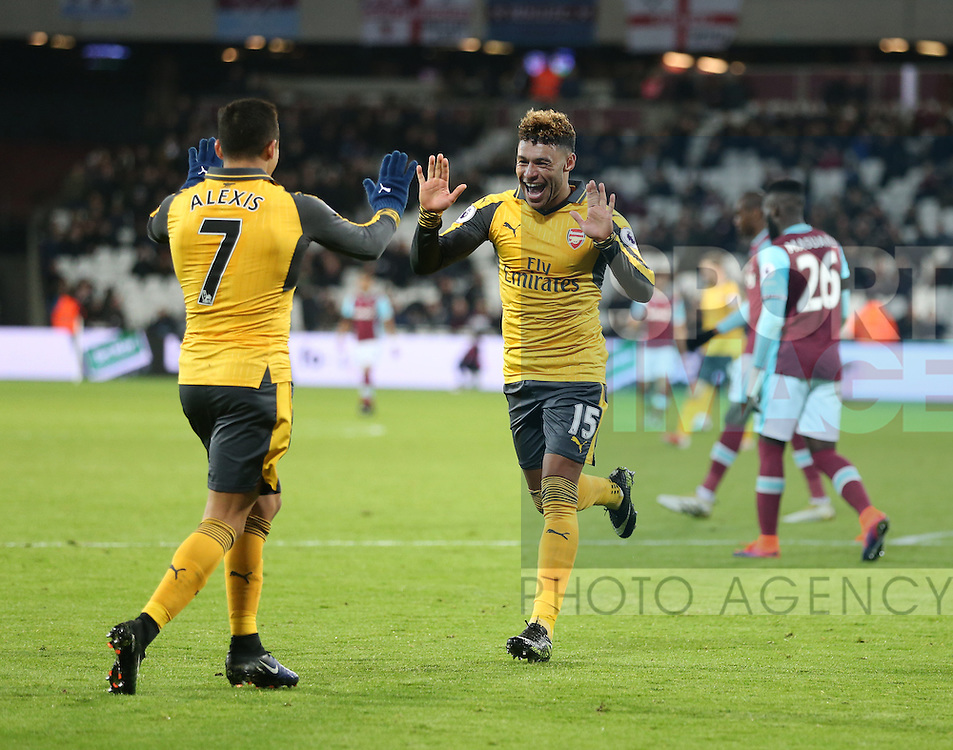 Arsenal's Alexis Sanchez celebrates scoring his sides fifth goal with Alex Oxlade-Chamberlain during the Premier League match at the London Stadium, London. Picture date December 3rd, 2016 Pic David Klein/Sportimage