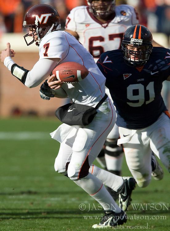 Virginia defensive end Chris Long (91) sacks Virginia Tech quarterback Sean Glennon (7) and forces a fumble.  The #8 ranked Virginia Tech Hokies defeated the #16 ranked Virginia Cavaliers 33-21 at Scott Stadium in Charlottesville, VA on November 24, 2007.