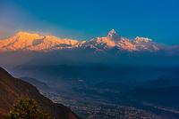 The peaks of the Annapurna Massif with the Pokhara Valley below, seen from Sarangkot,  near Pokhara, Nepal.