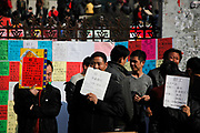 Factory recruiters, displaying hand-written signs of the type of employee skill-set they seek, wait for interested workers at an outdoor job market in Yiwu, Zhejiang Province, China on 21 February, 2011.  China's main export-oriented private manufacturing centers in the Yangtze and Pearl River Delta are facing a labour shortage after the Lunar New Year holidays, as an increasing number of migrant workers in  are staying put in the countryside due to rapid urbanization and economic development in China's interior, while those who continue to work in the traditional industrial belts such as Yiwu are demanding and receiving more wages and benefits.