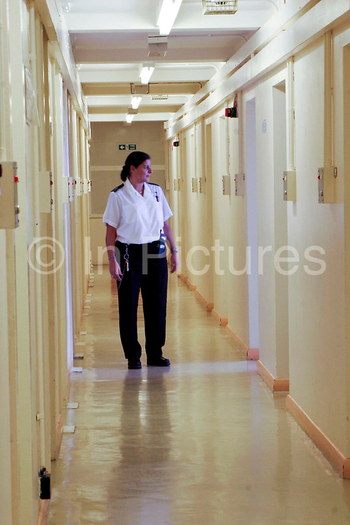 A female prison officer walking down a corridor of C wing at HMP Downview. HM Prison Downview is a women's closed category prison. Downview is located on the outskirts of Banstead in Surrey, England. The prison is operated by Her Majesty's Prison Service. Downview Prison holds adult Sentenced Female prisoners and convicted and remanded female juveniles. The prison holds approximately 50% foreign nationals. Downview is divided into 4 Wings, A,B,C,D (D wing is a resettlement Wing), and the Juvenile Unit. All wings have single cell accommodation with in-cell electricity. The prison offers vocational training courses and NVQs for inmates. The resettlement wing provides opportunities for inmates to work and receive education outside the prison.