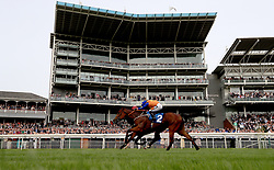 Baghdad (obscured) ridden by jockey William Buick on the way to winning the 7IM Supports Cystic Fibrosis Care Handicap alongside Making Miracles (front) ridden by jockey Silvestre de Sousa during day three of the 2018 Dante Festival at York Racecourse.