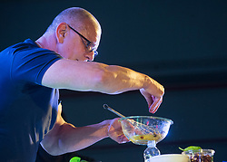 December 21, 2017 - Sevilla, Spain - Chef Robert Irvine performs a cooking demonstration during the Chairman?'s USO Holiday Tour at Moon Air Base Dec. 21, 2017. Marine Corps Gen. Joe Dunford, chairman of the Joint Chiefs of Staff, and Command Sgt. Maj. John W. Troxell, senior enlisted advisor to the chairman of the Joint Chiefs of Staff, along with USO entertainers, visited service members who are deployed from home during the holidays at various locations across Europe and the Middle East. .(Credit Image: ? US Navy/ZUMA Wire/ZUMAPRESS.com)