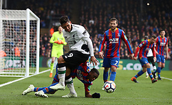 Liverpool's Roberto Firmino battles for possession of the ball with Crystal Palace's Aaron Wan-Bissaka