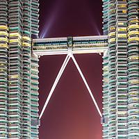 Skybridge between the iconic Petronas Twin Towers at dusk, Kuala Lumpur, Malaysia