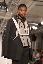 © Licensed to London News Pictures. 31/05/2014. London, England. Collection by Lillian Archibald with jewellry by  Isla Macer Law, Edinburgh College of Art. Graduate Fashion Week 2014, Runway Show at the Old Truman Brewery in London, United Kingdom. Photo credit: Bettina Strenske/LNP
