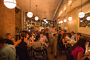 New York, NY, Sept. 10....shots of the restaurant Estela. The dinign room at Estela, looking towards the bar and the street.