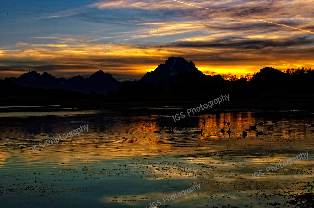 Beautiful Sunset Colors reflected in   OxBow Bend,on the Snake River with Mount Moran and the Teton Mountain range in the background