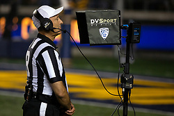 Referee Steven Strimling watches the video during a replay challenge by California during the fourth quarter of an NCAA college football game against Nevada, Saturday, Sept. 4, 2021, in Berkeley, Calif. (AP Photo/D. Ross Cameron)