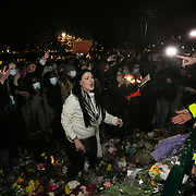 Hundreds of people gathered at a peaceful vigil for Sarah Everard on Clapham Common in South London on the 13th of March 2021, London, United Kingdom. Sarah Everard went missing on 3 March after setting off at 9pm from a friend's house to make her two-and-a-half-mile journey home and was days later found murdered. A women is protesting a the police's intervention. People had turned out to pay respect and love and mourn Sarah Everard as well as all the women and girls who on a daily basis are hurt by men. It was an event full of sadness and reflection and anger but peaceful. The vigil was not sanctioned by police because of Covid restrictions and the police decided to arrest a number of people in an attempt to break up the peaceful and highly emotional vigil. The event took place around the band stand on the common and speeches were held from the stand till police confiscated the sound equipment. The police have since been highly criticized for their handling of the event.