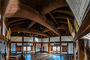 "Interior of Matsumoto Castle, built 1592-1614. Matsumoto, Nagano Prefecture, Japan. Matsumoto Castle is a ""hirajiro"" - a castle built on plains rather than on a hill or mountain. Matsumotojo's main castle keep and its smaller, second donjon were built from 1592 to 1614, well-fortified as peace was not yet fully achieved at the time. In 1635, when military threats had ceased, a third, barely defended turret and another for moon viewing were added to the castle. Interesting features of the castle include steep wooden stairs, openings to drop stones onto invaders, openings for archers, as well as an observation deck at the top, sixth floor of the main keep with views over the Matsumoto city. This image was stitched from multiple overlapping photos."