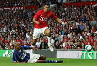 Photo: Paul Thomas.<br /> Manchester United v Inter Milan. Pre Season Friendly. 01/08/2007.<br /> <br /> Cristiano Ronaldo of Utd jumps over a Olivier Dacourt tackle.