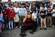 A wrestler adjust his mask after have suffered a fall in the ring. The street shows like wrestling attract public of any age in Ciudad Nezahualcoyotl, November 27, 2009.
