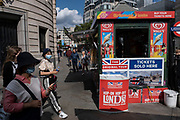 With many people and families staying in the UK for their Summer break during the school holidays, a large number of domestic tourists, who may normally have been travelling abroad, have decended on the capital to see the sights, as seen here in Trafalgar Square as even the hop-on hop-off tour bus operators are selling tickets from their kiosk again on 10th August 2021 in London, United Kingdom. Following the Coronavirus / Covid-19 health scare of the last two years, and with some travel restrictions still in place, more people have chosen a staycation which is a holiday spent in ones home country rather than abroad, or one spent at home and involving day trips to local attractions.