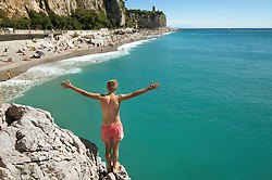 Teenager boy cliff holiday ocean waiting adventure