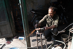 A little motorcycle repair shop in Kathmandu after our Himalayan motorcycling adventure, Nepal. Friday, November 16, 2018. Photography ©2018 Michael Lichter.