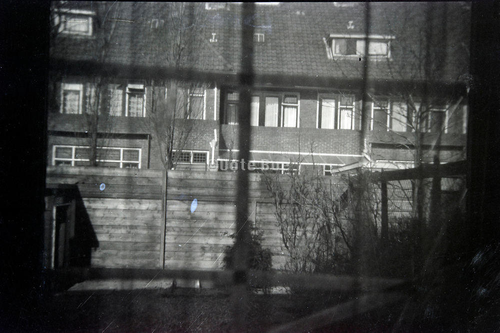 from inside view towards the row of houses on the other side of the backyard 1950s Netherlands
