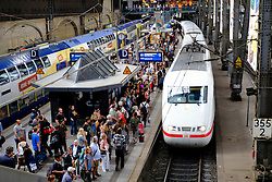 ICE high speed train arriving at platform in Hamburg Hauptbahnhof, main railway  station in Germany