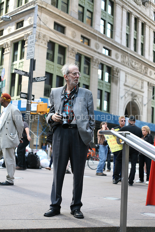 Photographer at the Occupy Wall Street protest at Zuccotti Park in the financial district New York